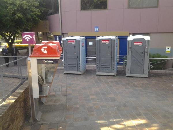 Portaloos in front of three broken toilets, Fitzroy Gardens, Kings Cross, 24 Apr 2015 (image)